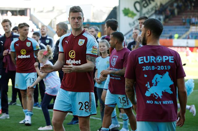 "Soccer Football - Premier League - Burnley vs AFC Bournemouth - Turf Moor, Burnley, Britain - May 13, 2018 Burnley's Kevin Long applauds their fans during a lap of honour after the match Action Images via Reuters/Craig Brough EDITORIAL USE ONLY. No use with unauthorized audio, video, data, fixture lists, club/league logos or ""live"" services. Online in-match use limited to 75 images, no video emulation. No use in betting, games or single club/league/player publications. Please contact your account representative for further details."