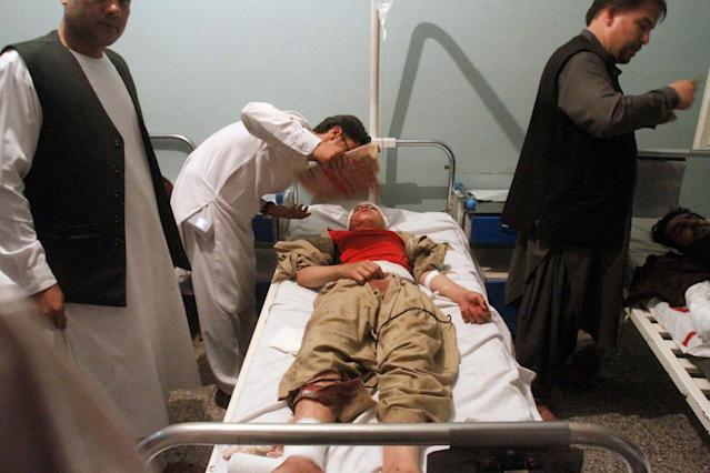 <p>Relatives assist a wounded man in a hospital after a suicide attack on a mosque in Herat, Afghanistan, Tuesday, Aug. 1, 2017. An Afghan hospital official says an explosion inside a minority Shiite mosque in western Herat, on the border with Iran, has killed at least 20 people. (Photo: Hamed Sarfarazi/AP) </p>