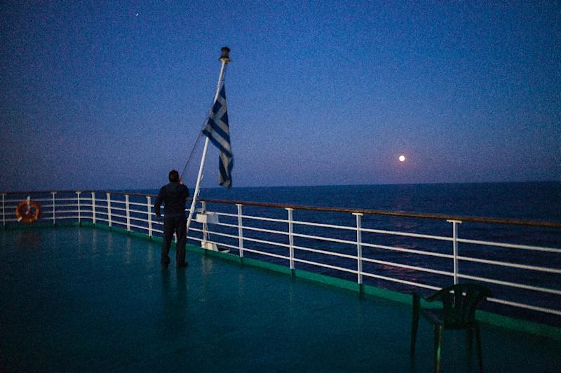 On the small Greek island of Anafi -- population 273 -- each ferry arrival is a notable event, with a mere two connections a week to the port of Piraeus, Anafiotes feel little love from the state in distant Athens (AFP Photo/ANGELOS TZORTZINIS)
