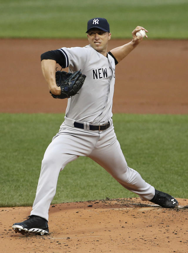 New York Yankees starting pitcher Chris Capuano delivers against the Boston Red Sox during the first inning of a baseball game at Fenway Park in Boston on Friday, Aug. 1, 2014. (AP Photo/Winslow Townson)