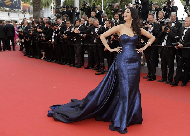 FILE - In this May 23, 2015 file photo, actress Mallika Sherawat poses for photographers upon arrival for the screening of the film Macbeth at the 68th international film festival, Cannes, southern France. The Paris prosecutor's office says Bollywood actress Mallika Sherawat and partner Cyrille Auxenfans were the targets of a botched robbery attempt involving tear gas in a posh area of the French capital. (AP Photo/Lionel Cironneau, File)