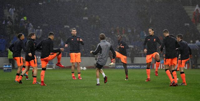 Soccer Football - Champions League Round of 16 First Leg - FC Porto vs Liverpool - Estadio do Dragao, Porto, Portugal - February 14, 2018 Liverpool's Dejan Lovren, Sadio Mane, Virgil van Dijk and team mates warm up before the match Action Images via Reuters/Matthew Childs