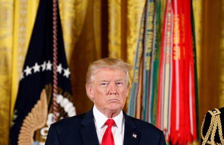 <p>U.S. President Donald Trump awards the Medal of Honor to James McCloughan, who served in the U.S. Army during the Vietnam War, during a ceremony at the White House in Washington, U.S. July 31, 2017. REUTERS/Joshua Roberts </p>