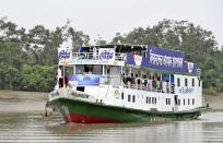 In this photo provided by Bidyanondo Foundation, floating hospital called 'Jibon Kheya',meaning lifeboat, arrives at Banishanta near Mongla seaport in southwestern region of Bangladesh, Sept. 1, 2020.. A Bangladeshi charity has set up a floating hospital turning a small tourist boat into a healthcare facility to provide services to thousands of people affected by this year's devastating floods that marooned millions. (Bidyanondo Foundation via AP)
