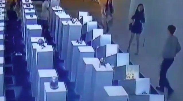 A gallery attendant (bottom right) comes rushing out to see what has happened. Picture: YouTube