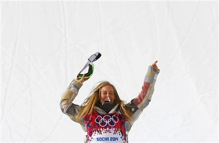 Jamie Anderson of the U.S. celebrates after the women's snowboard slopestyle finals event at the 2014 Sochi Winter Olympics in Rosa Khutor, February 9, 2014. Anderson laid down the best run of the day to clinch the first Olympic gold medal in women's snowboarding slopestyle at the Sochi Games on Sunday. REUTERS/Mike Blake