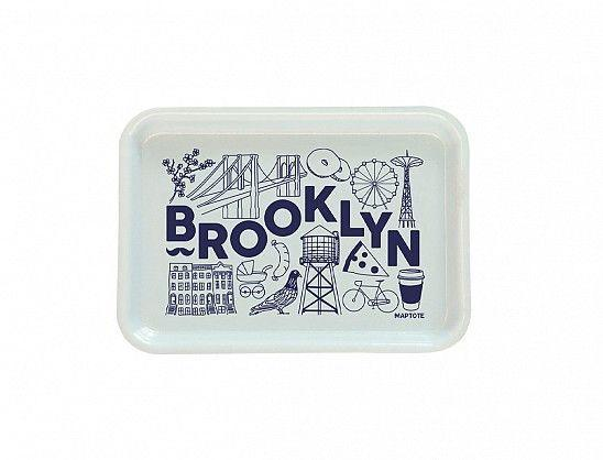 """<p><strong>Maptote</strong></p><p>maptote.com</p><p><strong>$12.00</strong></p><p><a href=""""https://maptote.com/shop/brooklyn-small-tray"""" rel=""""nofollow noopener"""" target=""""_blank"""" data-ylk=""""slk:Shop Now"""" class=""""link rapid-noclick-resp"""">Shop Now</a></p><p>A fun addition to any entryway, this city-themed catchall will remind your friends or family of what they love most about their newest home town. </p>"""