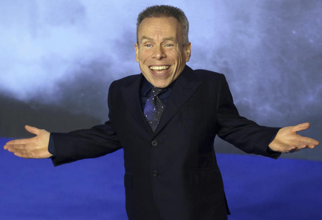 """Photo by: KGC-254/STAR MAX/IPx 2019 12/18/19 Warwick Davis at the premiere of """"Star Wars: The Rise of Skywalker"""" in London, England."""