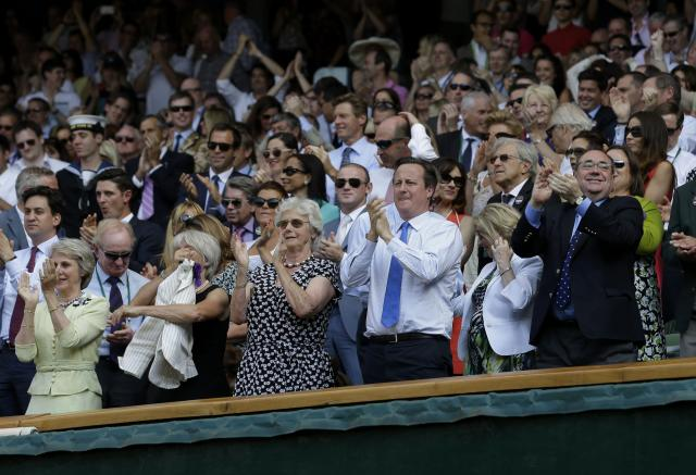 Prime Minister David Cameron (centre) applauds in the Royal Box near Scottish First Minister Alex Salmond (right) as Great Britain's Andy Murray plays Serbia's Novak Djokovic in the Men's Final during day thirteen of the Wimbledon Championships at The All England Lawn Tennis and Croquet Club, Wimbledon.