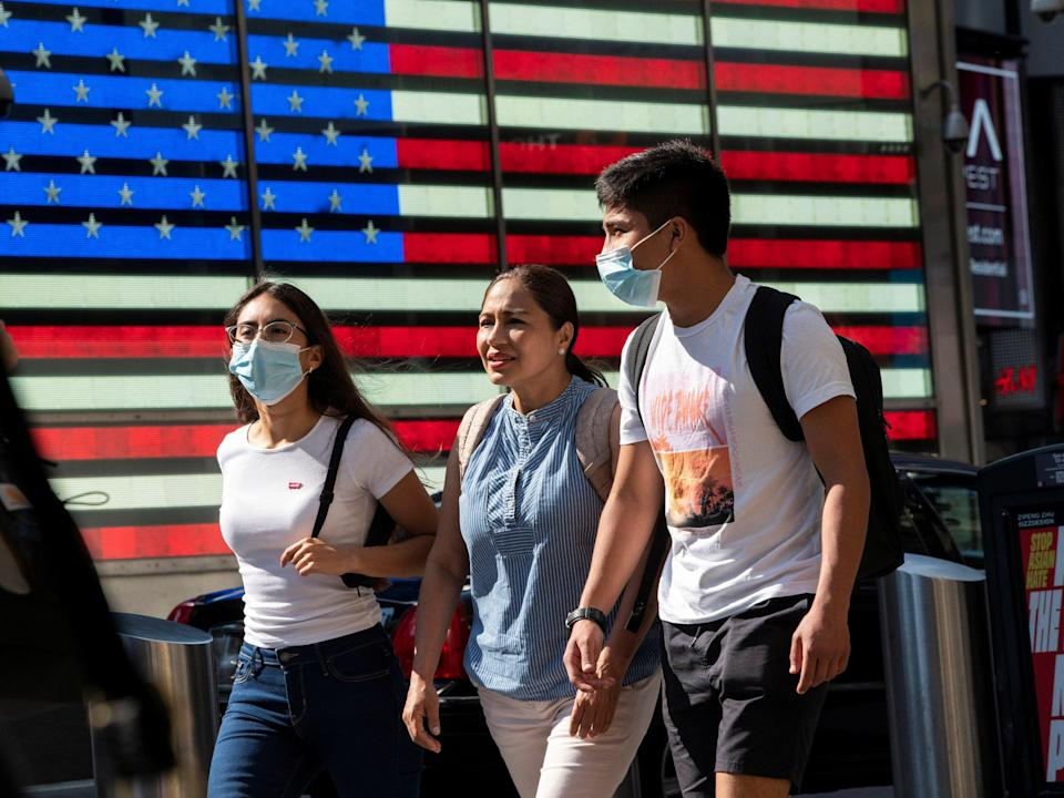 People wear masks around Times Square, as cases of the infectious coronavirus Delta variant continue to rise in New York City, New York (REUTERS)