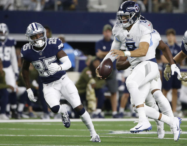 Tennessee Titans quarterback Marcus Mariota (8) runs out of the pocket against the Tennessee Titans during the first half of an NFL football game, Monday, Nov. 5, 2018, in Arlington, Texas. (AP Photo/Michael Ainsworth)
