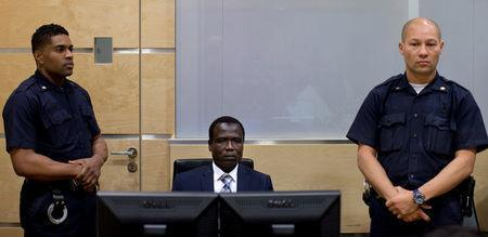 Dominic Ongwen, a Ugandan commander in the Lord's Resistance Army, waits for the start of court procedures as he makes his first appearance at the International Criminal Court in The Hague January 26, 2015. REUTERS/Peter Dejong/Pool/File Photo