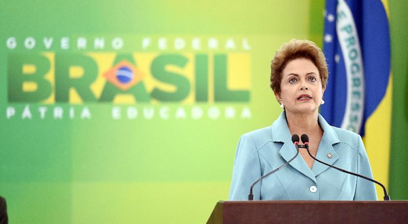Brazilian President Dilma Rousseff (pictured) said Wednesday she wanted to see greater trade cooperation between Brasilia and Beijing, and will push for a free trade accord during Li's visit (AFP Photo/Evaristo Sa)