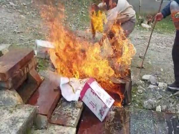 Visual of effigies burnt by the pilgrim priest in a protest against Devasthanam Board (Photo/ANI)