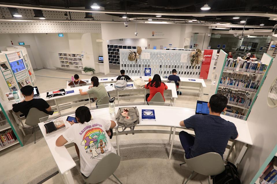 People studying in a public library are seated apart as part of social distancing measures on 19 March, 2020, in Singapore. (PHOTO: Getty Images)