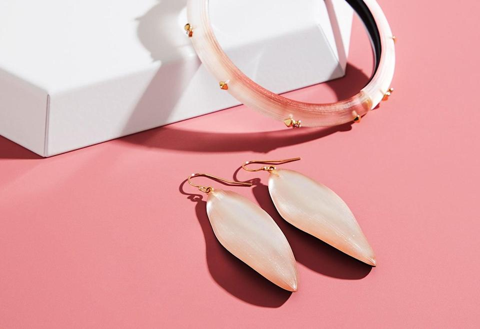 """<p><a href=""""https://www.popsugar.com/buy/Alexis-Bittar-Long-Leaf-Earrings-Golden-Studded-Hinge-Bracelet-531149?p_name=Alexis%20Bittar%20Long%20Leaf%20Earrings%20or%20Golden%20Studded%20Hinge%20Bracelet&retailer=alexisbittar.com&pid=531149&price=145&evar1=casa%3Aus&evar9=47010791&evar98=https%3A%2F%2Fwww.popsugar.com%2Fhome%2Fphoto-gallery%2F47010791%2Fimage%2F47010869%2FAlexis-Bittar-Long-Leaf-Earrings-or-Golden-Studded-Hinge-Bracelet&list1=shopping%2Cgifts%2Cneiman%20marcus%2Choliday%2Cmust%20have%20box%2Cpast%20boxes&prop13=api&pdata=1"""" rel=""""nofollow noopener"""" class=""""link rapid-noclick-resp"""" target=""""_blank"""" data-ylk=""""slk:Alexis Bittar Long Leaf Earrings or Golden Studded Hinge Bracelet"""">Alexis Bittar Long Leaf Earrings or Golden Studded Hinge Bracelet</a> ($145 each)</p> <p>It's that time of year when adding a little something special to your outfit can make all the difference. Customers could choose between two Alexis Bittar designs - the Long Leaf Earrings or the Studded Hinge Bracelet. Both come in a soft pink Lucite that matches almost everything in your closet. We consider them to be timeless classics.</p> <p><strong>Essentials We Also Love:</strong> <a href=""""https://www.popsugar.com/buy/Black-Pioneer-Gold-Tassel-Sunglasses-531157?p_name=Black%20Pioneer%20with%20Gold%20Tassel%20Sunglasses&retailer=alexisbittar.com&pid=531157&price=255&evar1=casa%3Aus&evar9=47010791&evar98=https%3A%2F%2Fwww.popsugar.com%2Fhome%2Fphoto-gallery%2F47010791%2Fimage%2F47010869%2FAlexis-Bittar-Long-Leaf-Earrings-or-Golden-Studded-Hinge-Bracelet&list1=shopping%2Cgifts%2Cneiman%20marcus%2Choliday%2Cmust%20have%20box%2Cpast%20boxes&prop13=api&pdata=1"""" rel=""""nofollow noopener"""" class=""""link rapid-noclick-resp"""" target=""""_blank"""" data-ylk=""""slk:Black Pioneer with Gold Tassel Sunglasses"""">Black Pioneer with Gold Tassel Sunglasses</a> ($255) and <a href=""""https://www.popsugar.com/buy/Navette-Crystal-Burst-Cocktail-Ring-531158?p_name=Navette%20Crystal%20Burst%20Cocktail%20Ring&retailer=alexisbittar."""