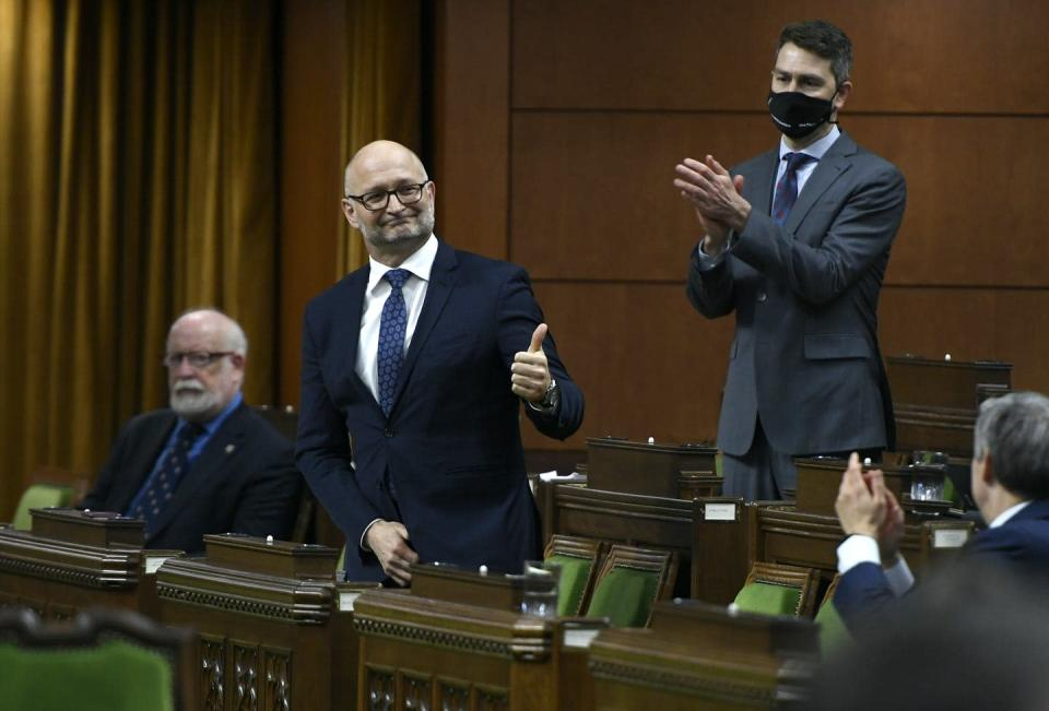 "<span class=""caption"">Minister of Justice David Lametti gives a thumbs up as he rises to vote in favour of a motion on Bill C-7, medical assistance in dying, in the House of Commons on Dec. 10, 2020. </span> <span class=""attribution""><span class=""source"">THE CANADIAN PRESS/Justin Tang</span></span>"