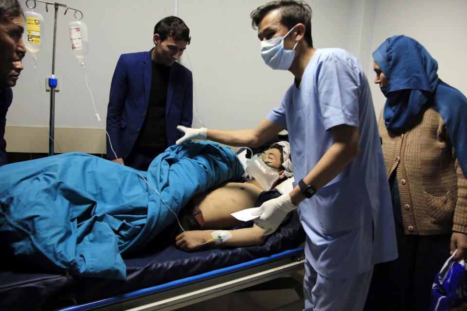 An Afghan receives treatment at hospital after suicide attack in Kabul, Afghanistan, Saturday, Oct. 24, 2020. The death toll from the suicide attack Saturday in Afghanistan's capital has risen that includes schoolchildren, the interior ministry said.. (AP Photo/Mariam Zuhaib)