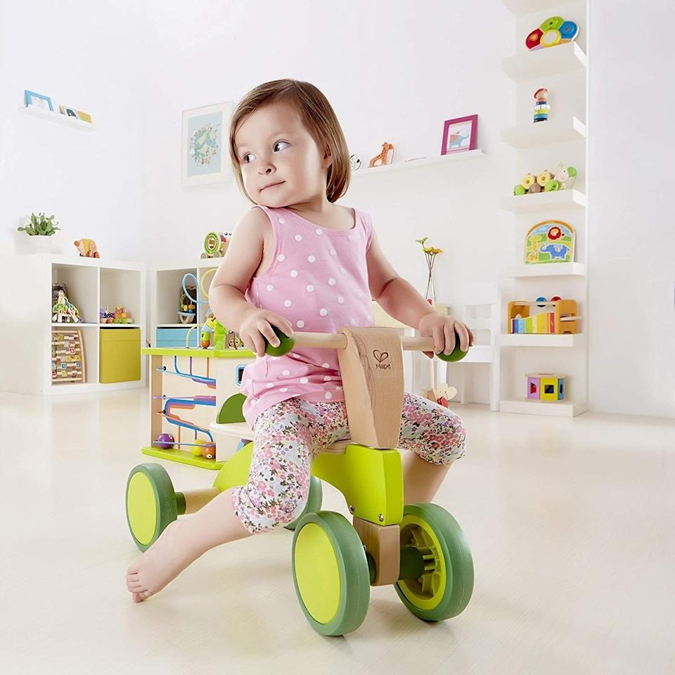 """This bike will take it easy on your floors thanks to its rubber wheels, and your toddler can develop motor skills as well as strength and balance.<br /><br /><strong>Promising review:</strong>""""This is the perfect scooter for a 1- to 3-year-old.<strong>When my son was learning to stand/walk, he'd use this as a walker by grabbing the handles and pushing it around.</strong>Sometimes he'd push from the back and scoot on his knees. He learned how to get on and off by himself after a year old. Now he can scoot. Pretty soon (When his legs grow a little longer) he'll get the idea and can really go!"""" —<a href=""""https://amzn.to/3euxYJs"""" target=""""_blank"""" rel=""""noopener noreferrer"""">Muffin</a><br /><strong><br />Get it from Amazon for<a href=""""https://amzn.to/3az94XJ"""" target=""""_blank"""" rel=""""noopener noreferrer"""">$67.65</a>.</strong>"""