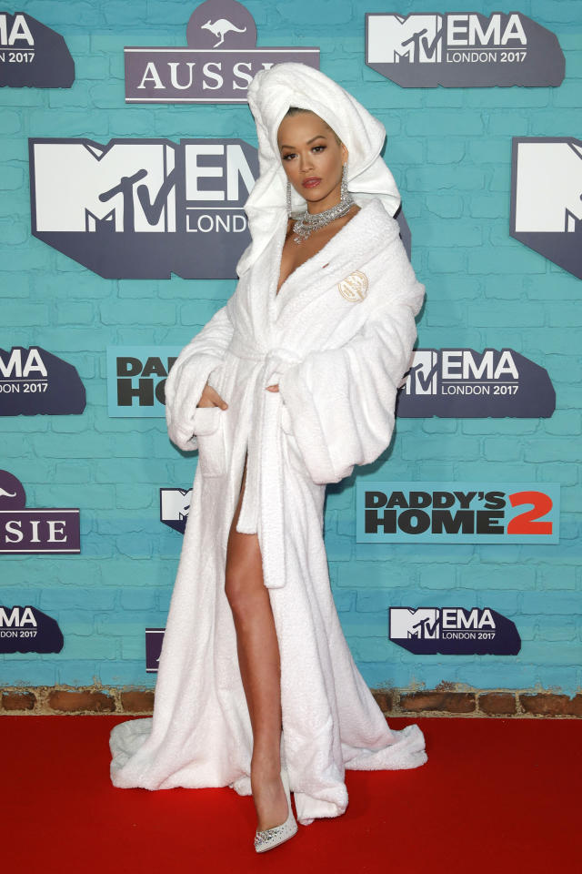 <p>Ensuring she hit headlines, Rita posed for photos on the red carpet wearing a bathrobe and diamonds. <em>[Photo: Getty]</em> </p>