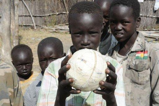 A handout picture released by the UN on January 5, shows internally displaced persons playing volleyball with a homemade ball in Pibor, Jonglei state after fleeing the surrounding areas following a wave of bloody ethnic violence. Over 3,000 people were killed in South Sudan in brutal massacres last week in an explosion of ethnic violence, a local official said Friday as the UN increased patrols