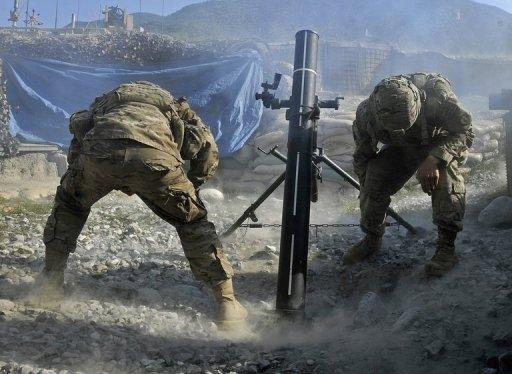 US army soldiers fire mortar rounds towards insurgent positions at Outpost Monti in Kunar province