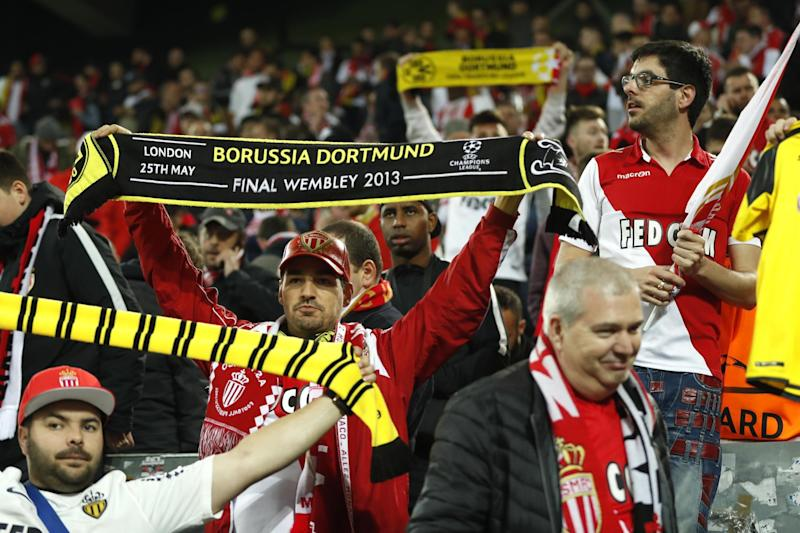 Rivals united | Monaco fans show support for the Dortmund players affected by the bomb attack: AFP/Getty Images