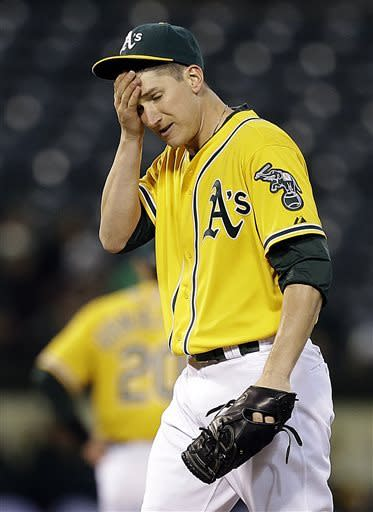 Oakland Athletics' Jarrod Parker wipes his face in the third inning of a baseball game against the Baltimore Orioles, Thursday, April 25, 2013, in Oakland, Calif. (AP Photo/Ben Margot)