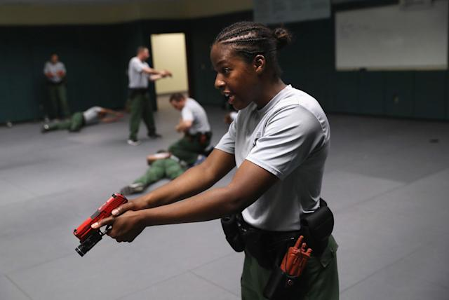 <p>A trainee practices take-down procedures with fellow agents at the U.S. Border Patrol Academy on August 2, 2017 in Artesia, N.M. (Photo: John Moore/Getty Images) </p>