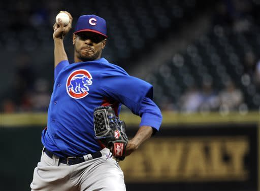 Chicago Cubs' Edwin Jackson delivers a pitch against the Houston Astros in the first inning of an exhibition baseball game on Friday, March 29, 2013, in Houston. (AP Photo/Pat Sullivan)