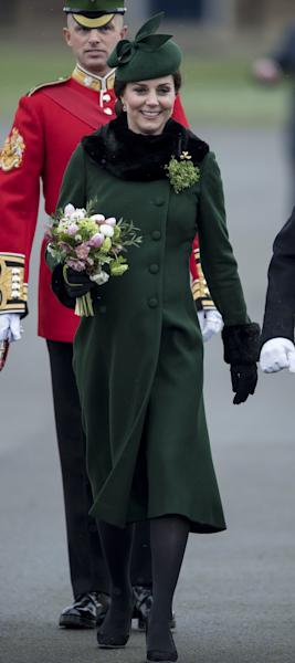 Kate Middleton, in a green Catherine Walker coat, and Prince William celebrated St. Patrick's Day in west London with the 1st Battalion of the Guards regiment.