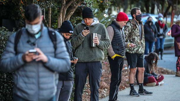 PHOTO: Voters wait on line to to cast their votes on Election Day, Nov. 3, 2020, in Atlanta.  (John Spink/Atlanta Journal-Constitution via AP)