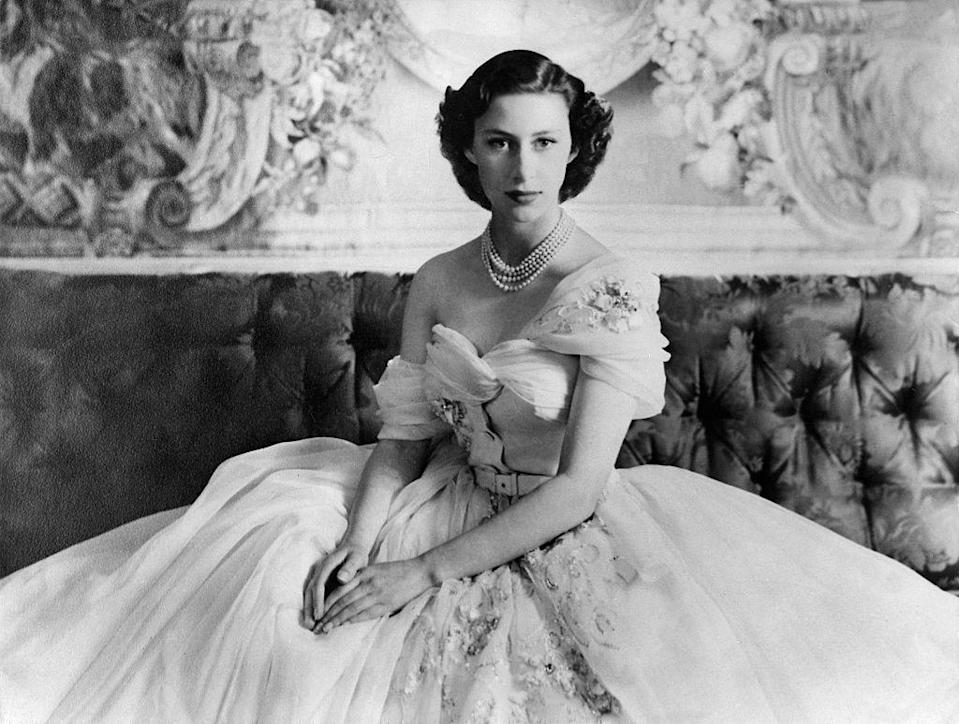 <p>In 1951, Margaret posed for a birthday portrait taken by Cecil Beaton in a one-shouldered cream gown with gold embellishment by Christian Dior. </p>