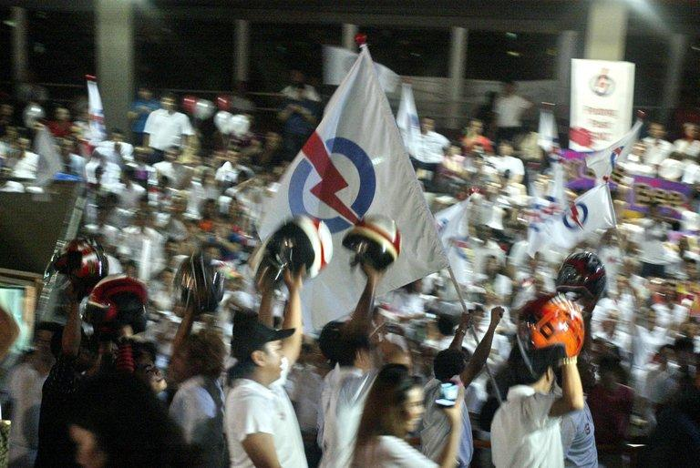 Supporters of Singapore's ruling People's Action Party celebrate after the general election in Singapore on May 8, 2011