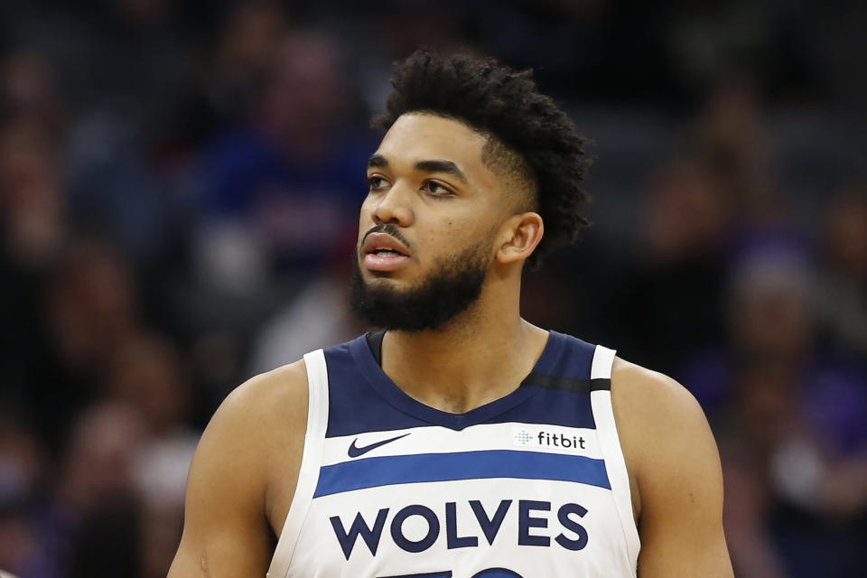 FILE - In this Feb. 3, 2020, file photo, Minnesota Timberwolves center Karl-Anthony Towns is shown during the second half of an NBA basketball game against the Sacramento Kings in Sacramento, Calif. Towns says his mother is hospitalized and in a medically-induced coma after contracting the new coronavirus. Towns talked about his mother's condition Wednesday, March 25, 2020, on his Instagram page and urged his followers to take COVID-19 seriously and practice social distancing. (AP Photo/Rich Pedroncelli, File)