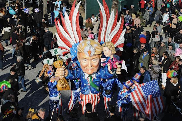 <p>A giant papier-mache float representing American President Donald Trump and Candidate Hillary Clinton moves through the streets of Viareggio during the traditional Carnival of Viareggio parade on Feb. 12, 2017 in Viareggio, Italy. (Photo: Laura Lezza/Getty Images) </p>