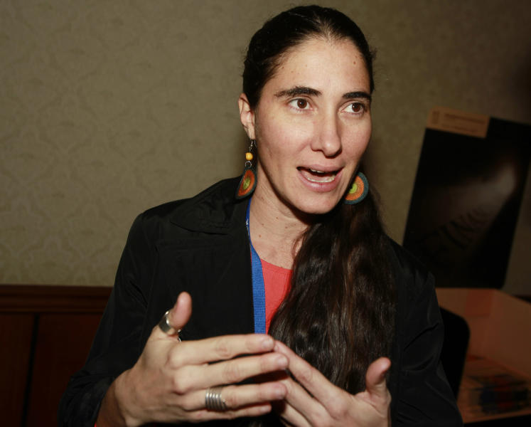 "FILE - In this Oct. 20, 2013, file photo, Yoani Sanchez, a dissident blogger from Havana, Cuba, talks about the difficulties of practicing her brand of news gathering during a session at the 69th Annual General Assembly of the Inter American Press Association in Denver. Leaders with the largest nonprofit organization for young Cuban-Americans quietly provided strategic support for the federal government's secret ""Cuban Twitter"" program, connecting contractors with potential investors and even serving as paid consultants, The Associated Press has learned. Roots of Hope has been a key player in events like Latin pop star Juanes' 2009 peace concert that drew more than a million people in Havana and in the promotion of technology on the island. Its leaders recently accompanied Sanchez to Washington, where she met with Vice President Joe Biden. (AP Photo/David Zalubowski, File)"