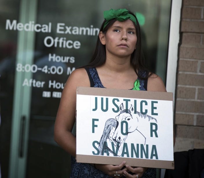 FILE - In this Aug. 29, 2017 file photo, Missy Jackson, 23, of Minneapolis, attends a prayer circle for Savanna LaFontaine-Greywind at the Ramsey County Medical Examiner's office in St. Paul, Minn. People wore green ribbons to honor Savanna, her favorite color. Interior Secretary Deb Haaland as a former New Mexico congresswoman pushed for a law signed last year to address the crisis of missing, murdered and trafficked Indigenous women. The law, known as Savanna's Act, is intended to help law enforcement track, solve and prevent crimes against Native Americans, especially women and girls. The law is named for Savanna LaFontaine-Greywind, a member of the Spirit Lake tribe who was abducted and killed in 2017 near Fargo, North Dakota. (Leila Navidi/Star Tribune via AP, File)