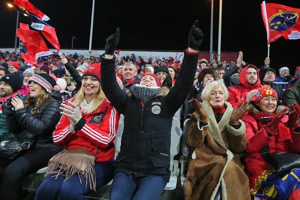 Munster supporters celebrate their first try during the European Rugby Champions Cup pool 1 match against Racing 92, at Thomond Park in Limerick, Ireland, in January 2017 (AFP Photo/Paul Faith)