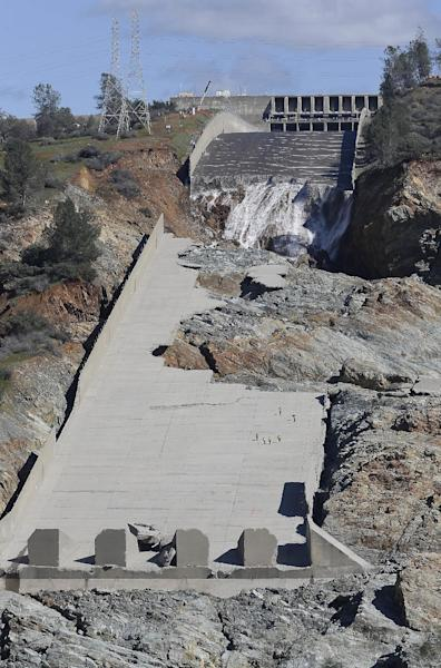Officials inspect Oroville Dam's crippled spillway Tuesday, Feb. 28, 2017, in Oroville, Calif. California water authorities stopped the flow of water down the spillway, Monday, allowing workers to begin clearing out massive debris that's blocking a hydroelectric plant from operating. (AP Photo/Rich Pedroncelli)