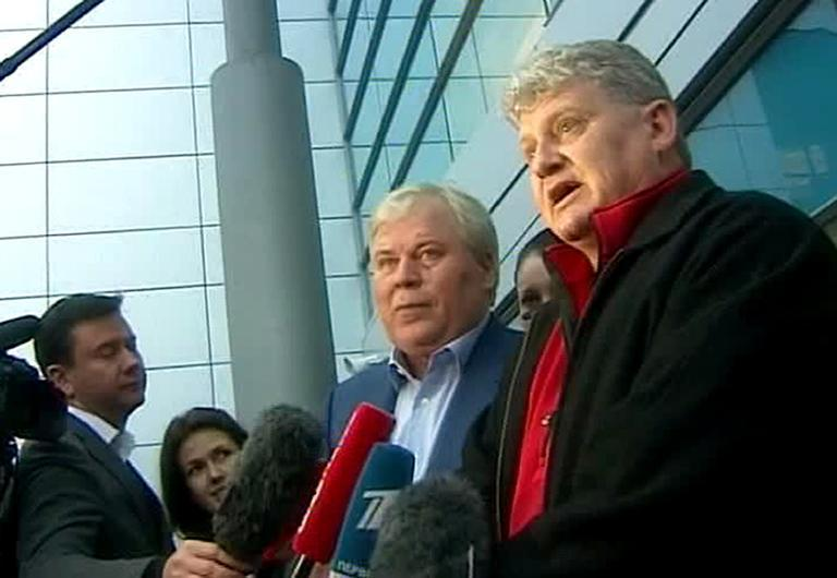 Rossiya 24 television grab on October 10, 2013, shows Lon Snowden (R), father of US intelligence leaker Edward Snowden, speaking on arrival at Moscow's Sheremetyevo airport, with Russian lawyer, Anatoly Kucherena (2nd R)