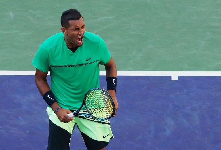 Nick Kyrgios of Australia celebrates match point against Novak Djokovic of Serbia to set up a quarter-final with Roger Federer at Indian Wells