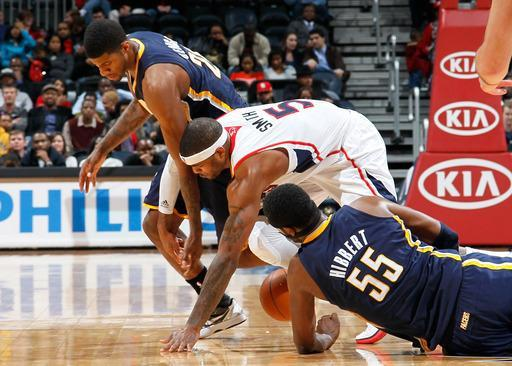 ATLANTA, GA - FEBRUARY 08: Josh Smith #5 of the Atlanta Hawks steals the ball from Paul George #24 and Roy Hibbert #55 of the Indiana Pacers at Philips Arena on February 8, 2012 in Atlanta, Georgia. (Photo by Kevin C. Cox/Getty Images)
