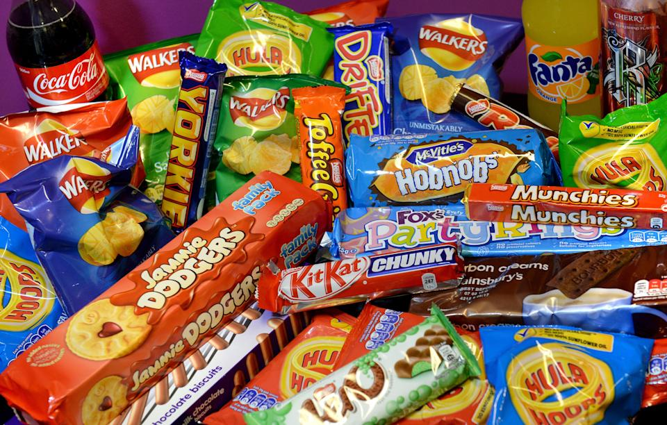 A collection of biscuits, crisps, chocolate bars and carbonated drinks (PA Archive)