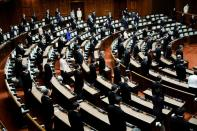 Lawmakers practice social distancing during the opening of an extraordinary session of parliament, in Tokyo