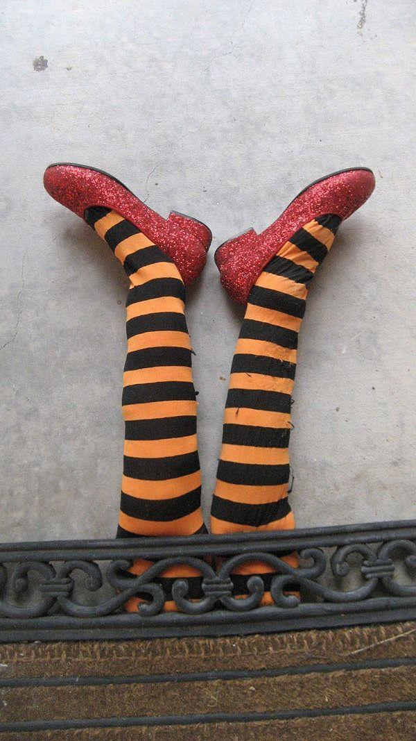 "<p>Stuff a pair of tights with paper and add some red, glittering shoes. Ding, dong...</p><p>See more at <a href=""http://www.cometogetherkids.com/2011/10/five-fun-ideas-for-halloween-decorating.html"" rel=""nofollow noopener"" target=""_blank"" data-ylk=""slk:Come Together Kids"" class=""link rapid-noclick-resp"">Come Together Kids</a>.</p>"