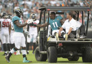 Jacksonville Jaguars running back Leonard Fournette, left, gives wide receiver Marqise Lee (11) a handshake after Lee was injured during the first half of an NFL preseason football game against the Atlanta Falcons, Saturday, Aug. 25, 2018, in Jacksonville, Fla. (AP Photo/Phelan M. Ebenhack)