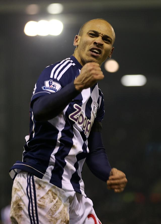 WEST BROMWICH, ENGLAND - JANUARY 19: Peter Odemwingie of West Bromwich Albion celebrates scoring their second goal during the Barclays Premier League match between West Bromwich Albion and Aston Villa at The Hawthorns on January 19, 2013 in West Bromwich, England. (Photo by Ian Walton/Getty Images)