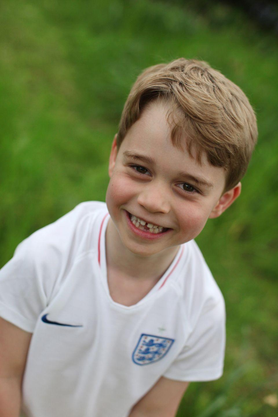 <p>The second picture in the birthday series shows Prince George wearing a soccer jersey.</p>