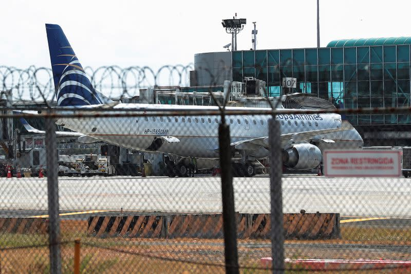 A Copa Airlines plane sits in the tarmac is pictured at Tocumen International Airport after the Panamanian government restricted flights in recent days due to the coronavirus disease outbreak (COVID-19), in Panama City